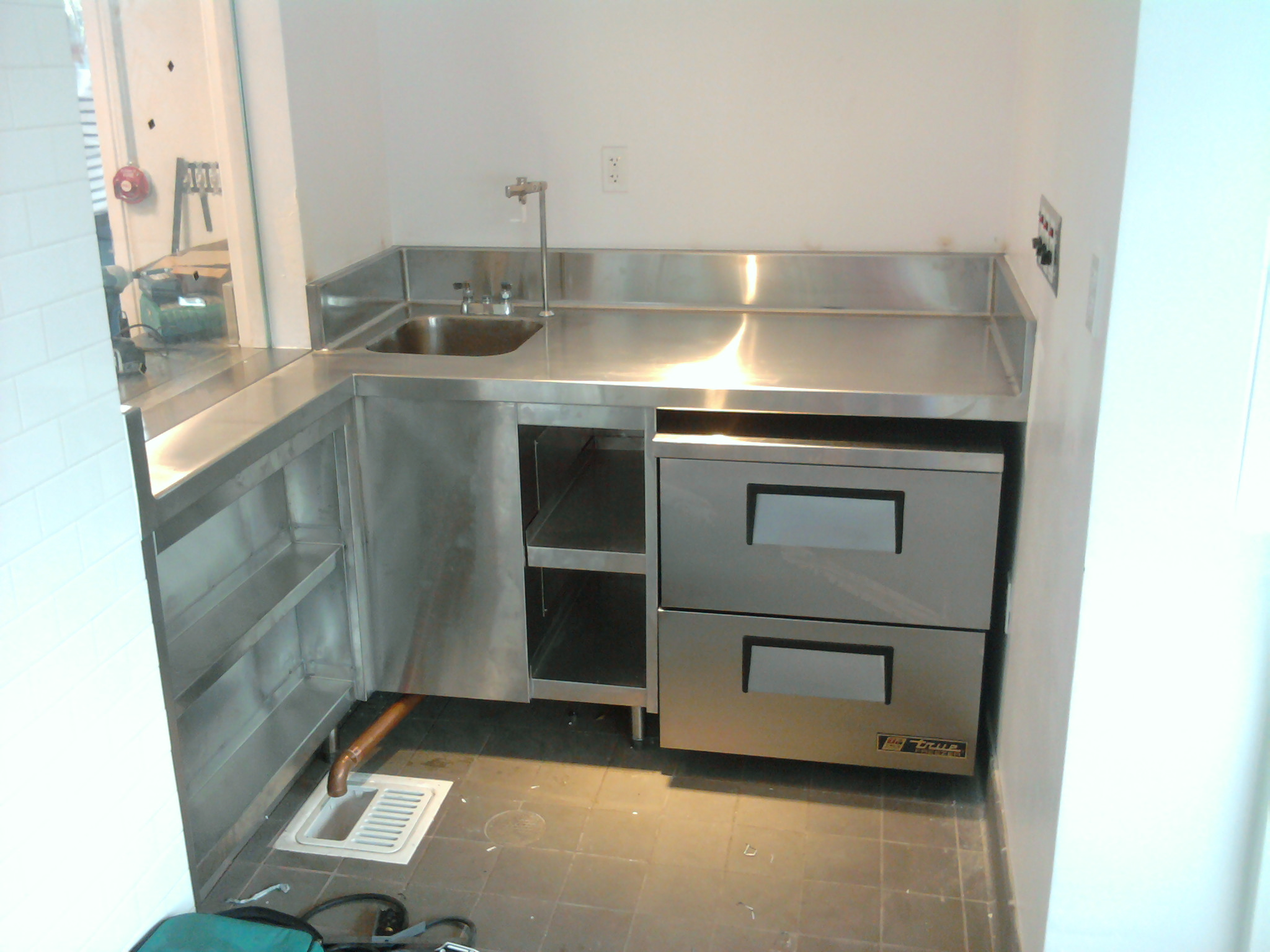 Delightful Stainless Steel Countertop With Under Counter Shelves
